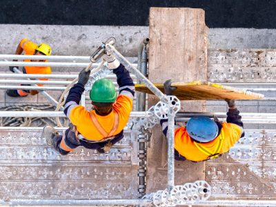 Workers,Seen,From,Above,Setting,Scaffolding,On,A,Facade