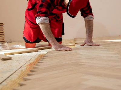 Handyman,Installing,Wooden,Flooring,,Worker,Laying,Parquet,Flooring.,Worker,Installing